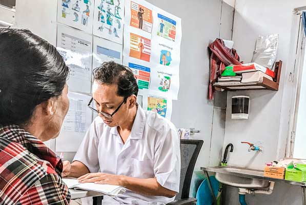 Daw Htay, a patient with Dr. Sha, Medical Director at the T-RAD Clinic